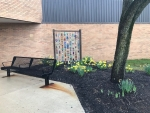 West Central school outside bead artwork and bench
