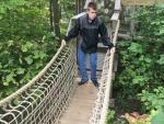 Young man on bridge