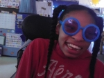 Girl wearing silly glasses